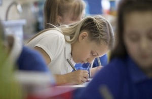 Female pupil writing